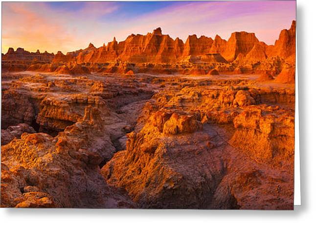 Badlands National Park Greeting Cards - Alpenglow On Rock Formations Greeting Card by Panoramic Images
