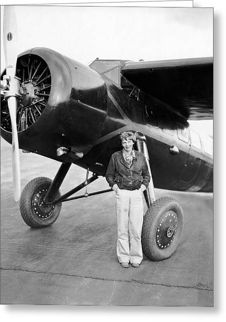 Amelia Earhart And Her Plane Greeting Card by Underwood Archives