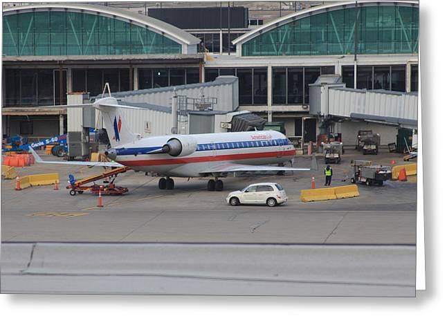 American Bridge Company Greeting Cards - American Airlines plane at Chicago OHare airport Greeting Card by Ash Sharesomephotos