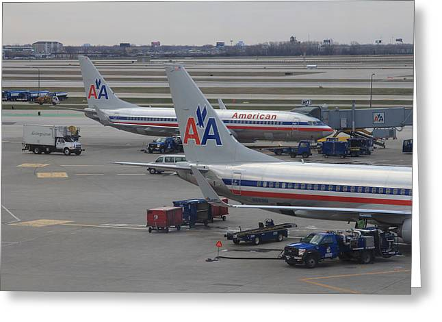 American Bridge Company Greeting Cards - American Airlines planes at Chicago OHare airport Greeting Card by Ash Sharesomephotos