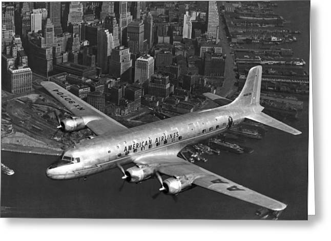 American Dc-6 Flying Over Nyc Greeting Card by Underwood Archives