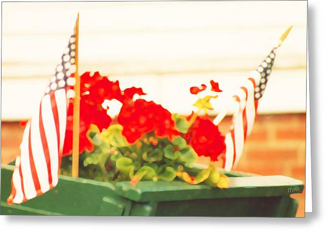 Red Geraniums Greeting Cards - American Flags And Geraniums In A Wheelbarrow One Greeting Card by Marian Cates