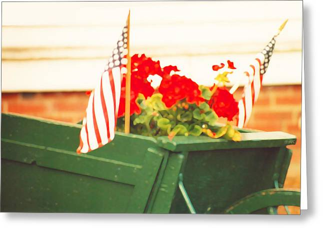 Red Geraniums Greeting Cards - American Flags And Geraniums In A Wheelbarrow Two Greeting Card by Marian Cates