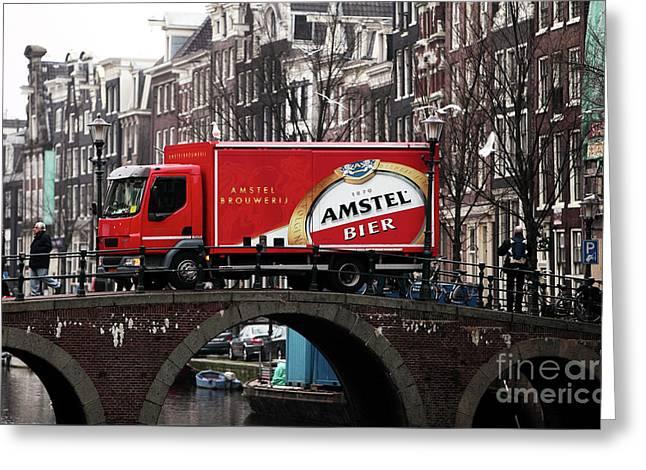 Amstel Bier Greeting Card by John Rizzuto