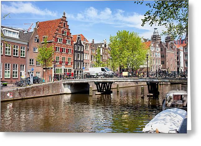 Amsterdam Canal Bridge And Houses Greeting Card by Artur Bogacki