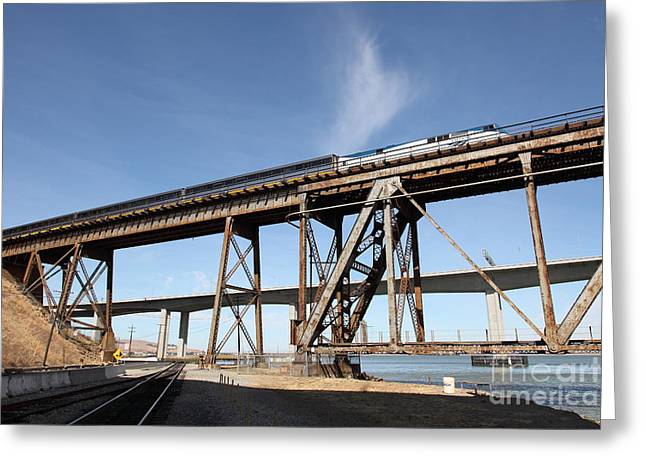Amtrak Train Riding Atop The Benicia-martinez Train Bridge In California - 5d18775 Greeting Card by Wingsdomain Art and Photography