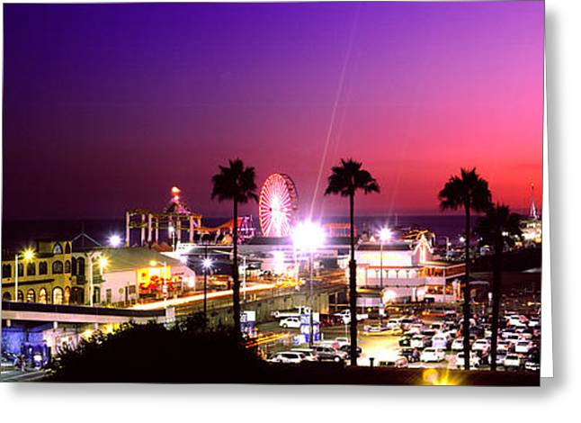 Amusements Greeting Cards - Amusement Park Lit Up At Night, Santa Greeting Card by Panoramic Images