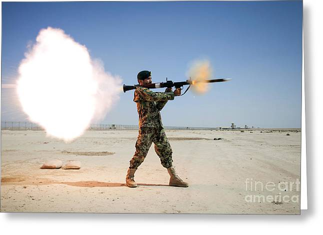 An Afghan National Army Soldier Fires Greeting Card by Stocktrek Images