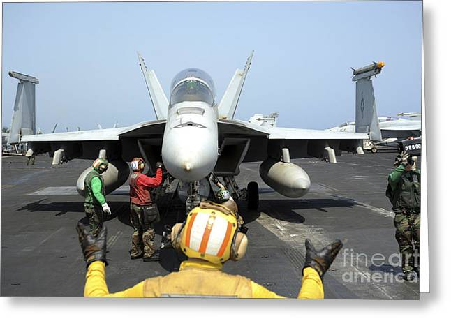 F-18 Greeting Cards - An Aircraft Director Signals Greeting Card by Stocktrek Images