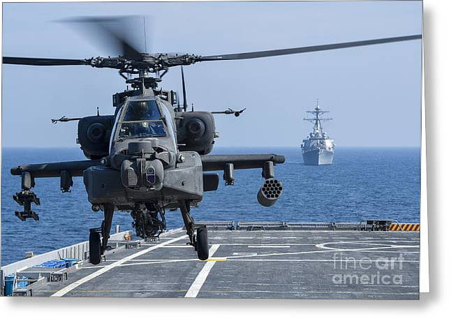Ponce Greeting Cards - An Army Ah-64d Apache Helicopter Takes Greeting Card by Stocktrek Images