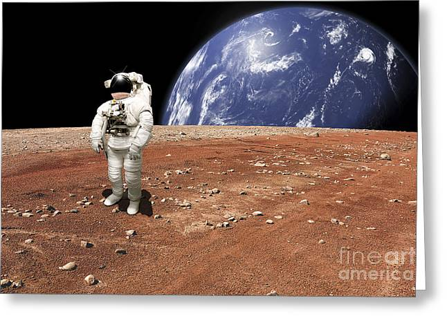 Earth Alone Greeting Cards - An Astronaut Standing On A Barren World Greeting Card by Marc Ward