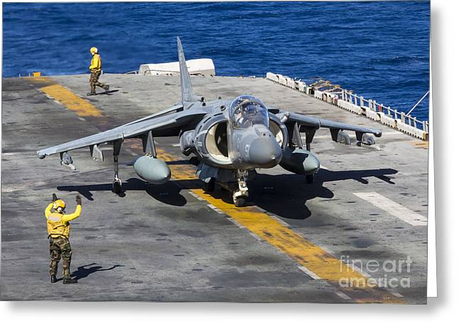 Military Airplanes Greeting Cards - An Av-8b Harrier Prepares To Take Greeting Card by Stocktrek Images