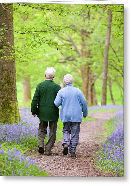 An Elderly Couple Walking Greeting Card by Ashley Cooper