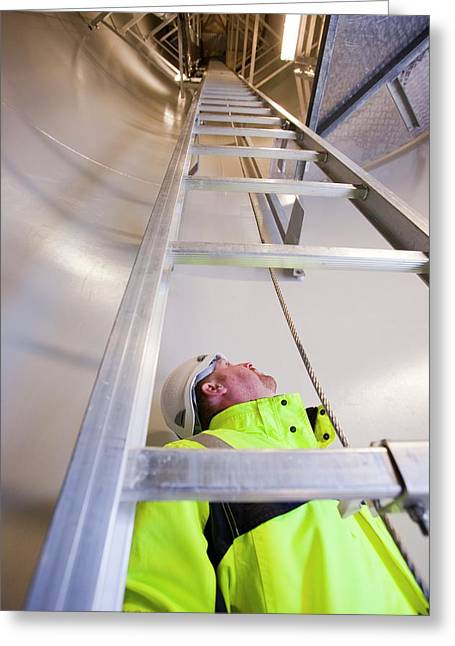An Engineer Climbs A Wind Turbine Greeting Card by Ashley Cooper