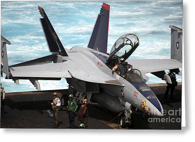 F-18 Greeting Cards - An Fa-18f Super Hornet Sits Greeting Card by Stocktrek Images