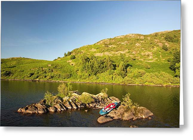 An Inflatable Kayak On Ullswater Greeting Card by Ashley Cooper
