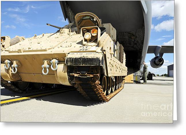 Battle Tanks Greeting Cards - An M2m3 Bradley Fighting Vehicle Drives Greeting Card by Stocktrek Images