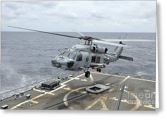 An Mh-60r Sea Hawk Helicopter Lifts Greeting Card by Stocktrek Images