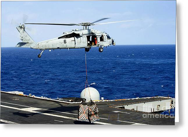 At Arrivals Greeting Cards - An Mh-60r Seahawk Helicopter Places Greeting Card by Stocktrek Images