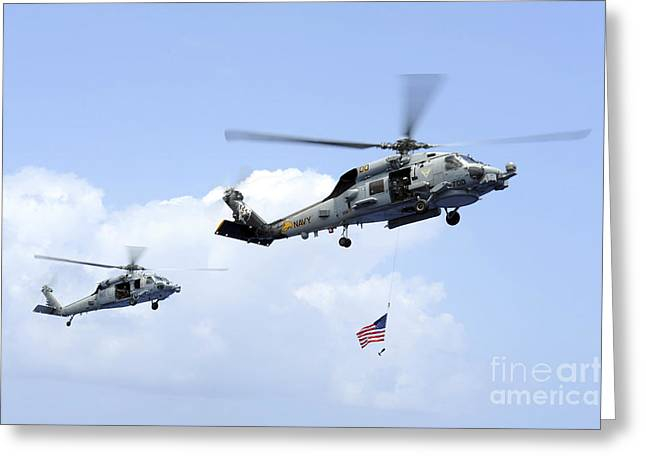 Carrier Greeting Cards - An Mh-60s Sea Hawk Helicopter Follows Greeting Card by Stocktrek Images