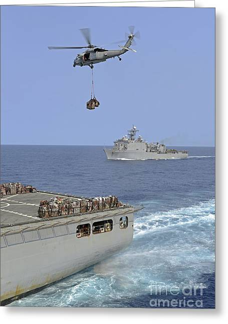 At Arrivals Greeting Cards - An Mh-60s Sea Hawk Helicopter Transfers Greeting Card by Stocktrek Images
