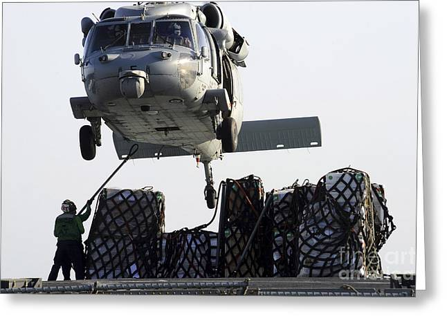 Netting Greeting Cards - An Mh-60s Sea Hawk Picks Up Supplies Greeting Card by Stocktrek Images
