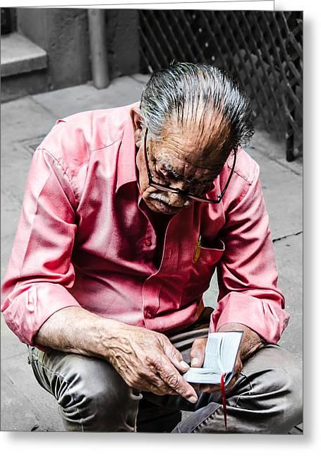 An Old Man Reading His Book Greeting Card by Sotiris Filippou