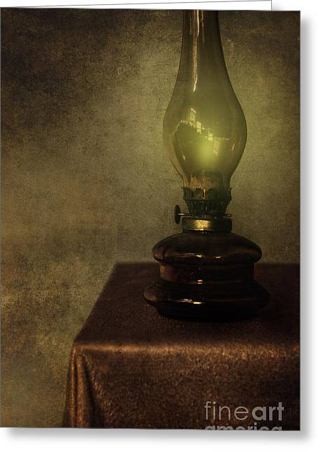 An Old Oil Lamp On The Table Greeting Card by Jaroslaw Blaminsky