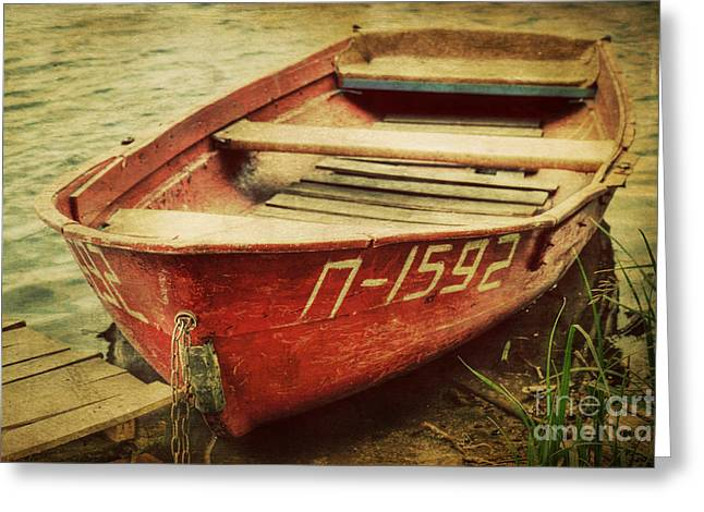 Wooden Dock Greeting Cards - An Old Row Boat Greeting Card by Emily Enz