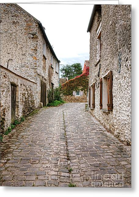 Cobblestone Street Greeting Cards - An Old Village Street Greeting Card by Olivier Le Queinec