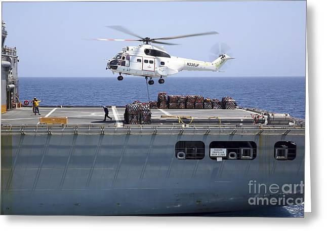 Hovering Greeting Cards - An Sa-330j Puma Helicopter Delivers Greeting Card by Stocktrek Images