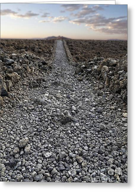 Road Trip Photographs Greeting Cards - Ancient rocky road leading to the horizon. Greeting Card by Edward Fielding