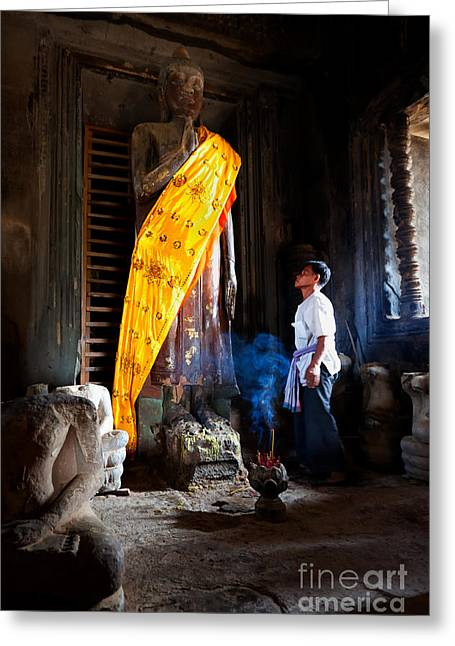 Historical Images Greeting Cards - Angkor Wat Devotee Lights Incense in Buddha Temple Greeting Card by Jo Ann Tomaselli