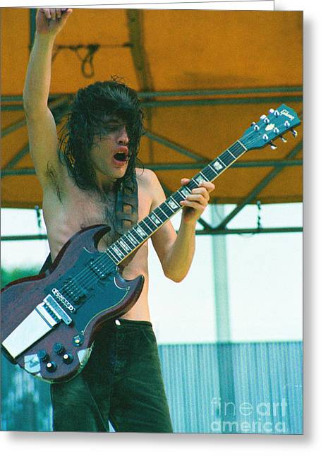 Angus Young Greeting Cards - Angus Young of AC DC at Day on the Green Monsters of Rock - July 1979  Greeting Card by Daniel Larsen