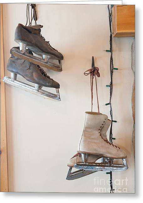 Antique Skates Greeting Cards - Antique ice skates hanging on a wall. Greeting Card by Don Landwehrle