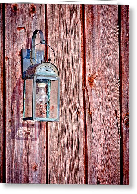 Bard Door Greeting Cards - Antique Lantern On Weathered Red Barn Greeting Card by Jeff Sinon