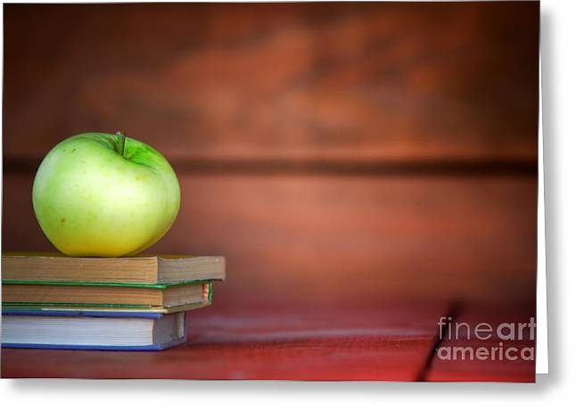 First-class Greeting Cards - Apple on pile of books Greeting Card by Michal Bednarek