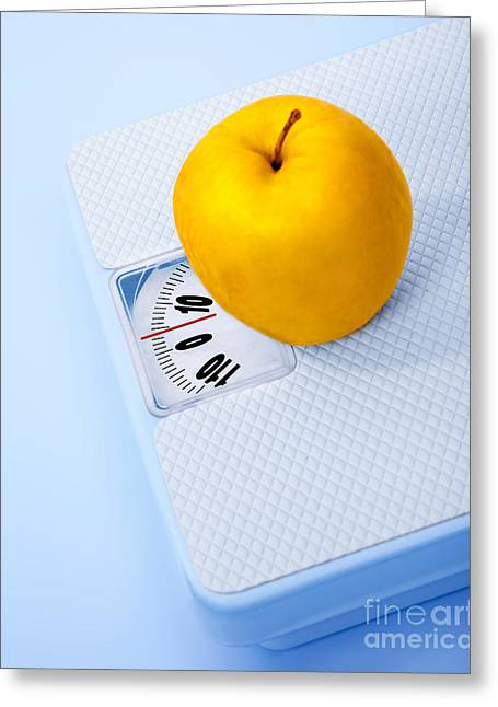 Skinny Greeting Cards - Apple on scale Greeting Card by Anna Omelchenko