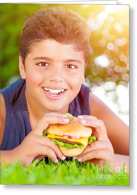 Kid Eating Snack Greeting Cards - Arabic boy eating burger outdoors Greeting Card by Anna Omelchenko