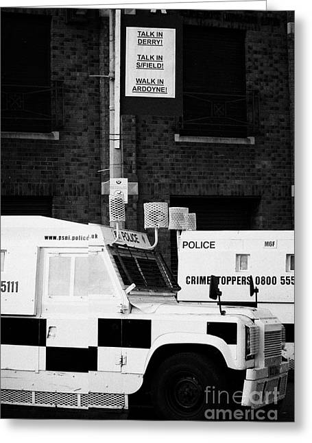Terrorist Greeting Cards - Armoured PSNI land rovers under protest sign banner on crumlin road at ardoyne  Greeting Card by Joe Fox