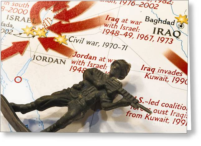 Iraq Conflict Greeting Cards - Army Man lying on Middle East Conflicts Map Greeting Card by Amy Cicconi
