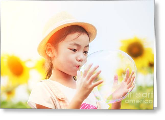 Sunflower Joy Greeting Cards - Asian little girl is blowing a soap bubbles in sunflower garden Greeting Card by Anek Suwannaphoom