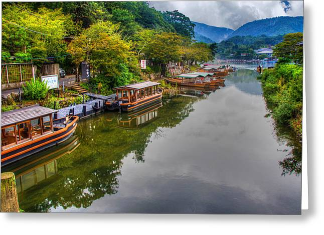 Laura Palmer Greeting Cards - Asian pleasure boats wait on the river Hozu in Japan Greeting Card by Laura Palmer