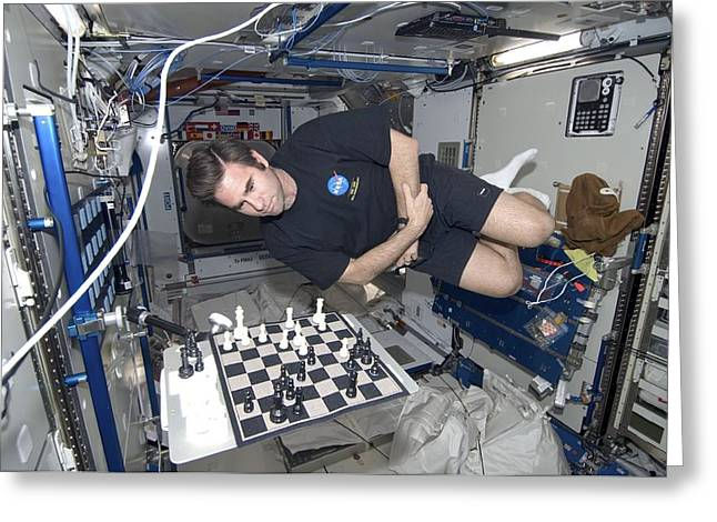 Mcc Greeting Cards - Astronaut chess game on the ISS Greeting Card by Science Photo Library