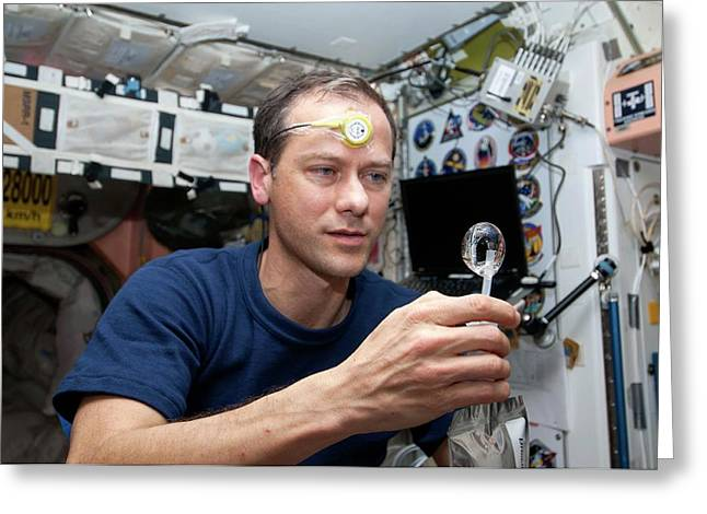 Astronaut On The Iss Greeting Card by Nasa