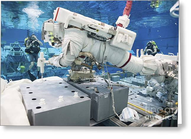Buoyancy Greeting Cards - Astronaut Simulates A Spacewalk Greeting Card by Stocktrek Images