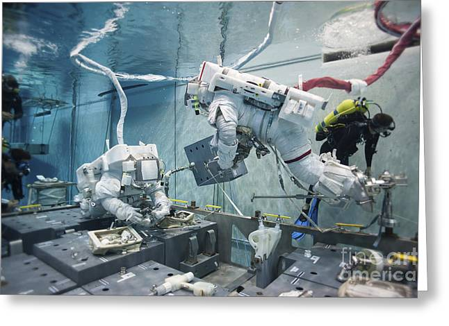 Buoyancy Greeting Cards - Astronauts Simulate A Spacewalk Greeting Card by Stocktrek Images