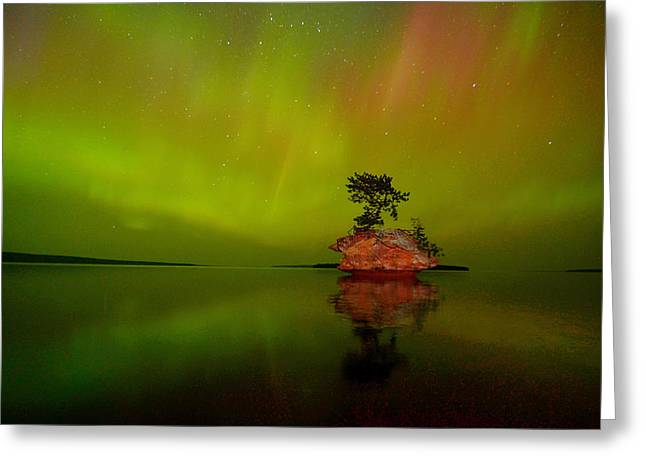 Northernlights Greeting Cards - Aurora over Honeymoon Rock in Lake Superior Greeting Card by Jeff Rennicke
