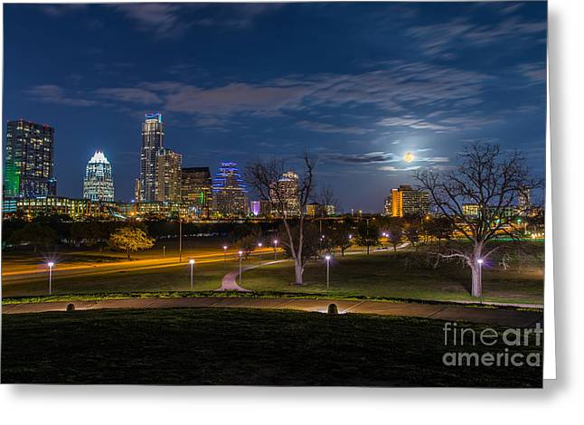 Austin At Night Greeting Cards - Austin Skyline with Easter Moon Greeting Card by Tod and Cynthia Grubbs