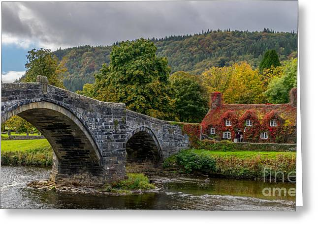 Stone Bridge Greeting Cards - Autumn Cottage Greeting Card by Adrian Evans